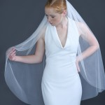 "948-40  40"" (70"") cut edge English net on a silver comb…. Ivory tulle only……………………………………"