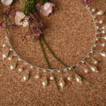A-5637  A headband of linear teardrop pearls and round pearls on a thin base wrapped with delicate pearls & crystals……..(Ivory or white pearls)………*Silver or gold