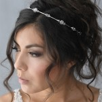 A-5662  Delicate headband of spaced rhinestone flowers & tri rhinestones………*Silver………………………