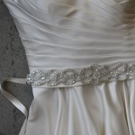 """B-118  83"""" long 5/8"""" double face satin sash with a 16"""" long, 2 ¼"""" wide appliqué outlined with silver threads dotted with round rhinestones……*Silver………All ribbon colors ."""
