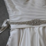 "B-125  83"" long 5/8"" double face satin sash with a 15 ½"" long rhinestone appliqué with an oval rhinestone center 1 ¾"" wide, graduating to ¾"" side width ………….*Silver……………………All ribbon colors ……"