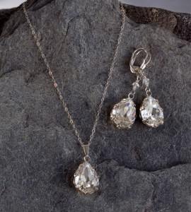 "J-9150 J-9151 J-9150 2″ long earrings of set faceted pear shape rhinestone pendants. (To match J-9151) *Silver Only J-9151 17 ½"" necklace of delicate chain with a set pear shape faceted rhinestone pendant. (To match J-9150) *Silver Only"